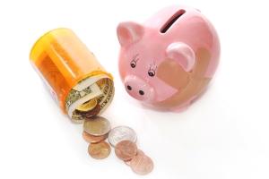 stockvault-piggy-bank-with-pill-bottle127632